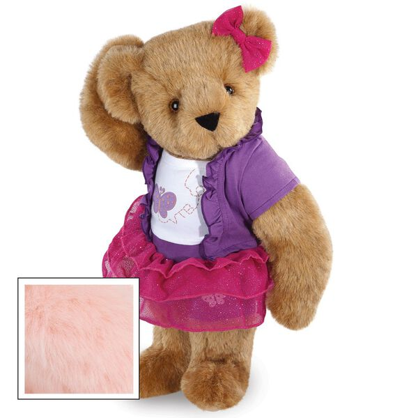 """15"""" Glitter Whimsy Bear - Three quarter view of standing jointed bear dressed in a pink skirt and hair bow, white shirt with butterfly graphic, purple shorts and sweater - Pink fur image number 5"""