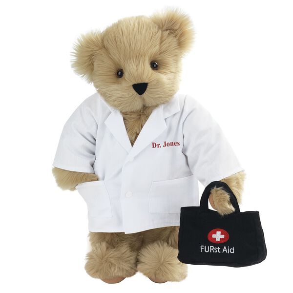 "15"" Doctor Bear - Front view of standing jointed bear dressed in white labcoat holding a doctor bag that is embroidered wth ""FURst Aid"" and a medical cross in red and white personalized with ""Dr. Jones"" on left chest in red - Maple brown fur image number 3"
