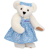 "15"" Mother Bear - Three quarter view of standing jointed bear dressed in blue floral dress and hair bow personalized with ""Susan"" in purple on bodice of dress - Vanilla white fur image number 3"