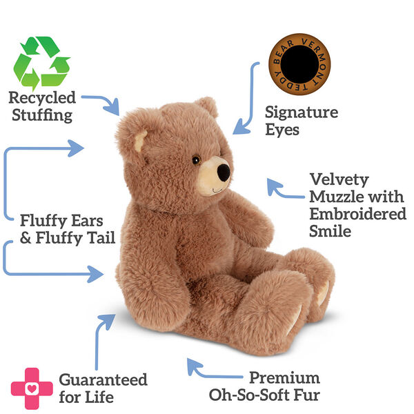 """18"""" Oh So Soft Teddy Bear - Side view of seated honey brown bear, text around bear says""""Signature Eye; Velvety Muzzle with Embroidered Smile; Premium Oh So Soft Fur; Guaranteed For Life' Fluffy Ears and Tail; Recycled Stuffing"""" image number 2"""