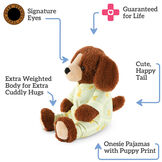 """13"""" PJ Pal Puppy- 3 quarter view of cinnamon brown Puppy with tan muzzle in yellow cotton pajamas. Text reads, """"Signature Eyes; Guaranteed For Life; Cute, Happy Tail; Onesie Pajamas with Puppy Print; Extra Weighted Body for Extra Cuddly Hugs"""".  image number 2"""