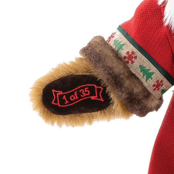 """15"""" Limited Edition Woodland Santa Bear - Close up of bear's left paw with """"1 of 35"""" embroidered in gold lettering image number 3"""