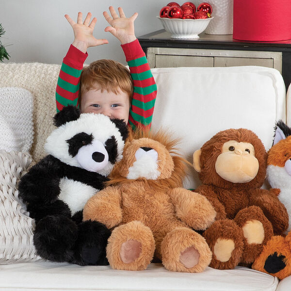 "18"" Oh So Soft Panda Bear - Front view of 18"" Panda, 18"" Lion and 18"" Monkey sitting on a couch with a boy in pajamas playing with them image number 3"