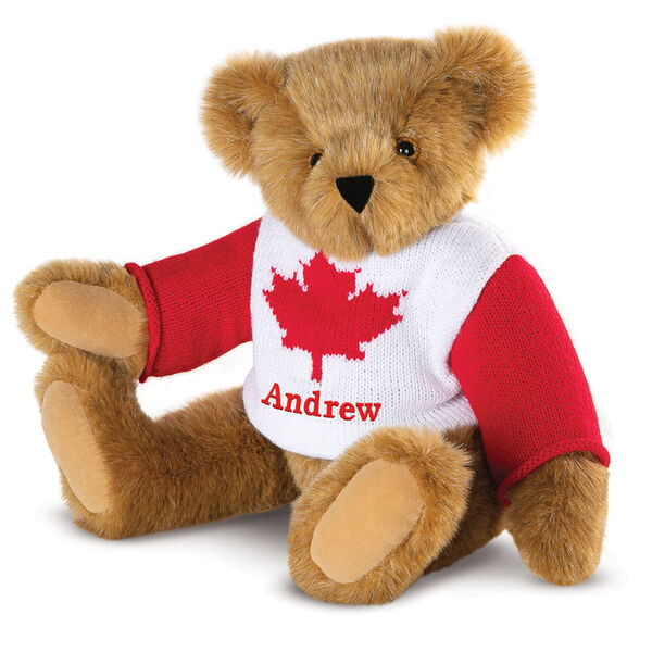 "15"" Maple Leaf Sweater Bear - Three quarter view of seated jointed bear dressed in white knit sweater with red maple leaf on front and red sleeves personalized with ""Andrew"" below leaf in red - Honey brown fur image number 5"