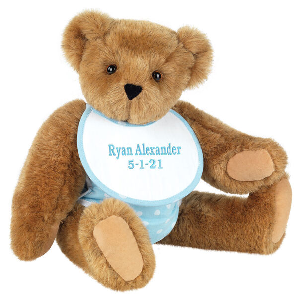 "15"" Baby Boy Bear - Seated jointed bear dressed in light blue with white dots fabric diaper and bib. Bib with ""Ryan Alexander"" and ""5-1-21"" in light blue lettering - Honey brown fur"
