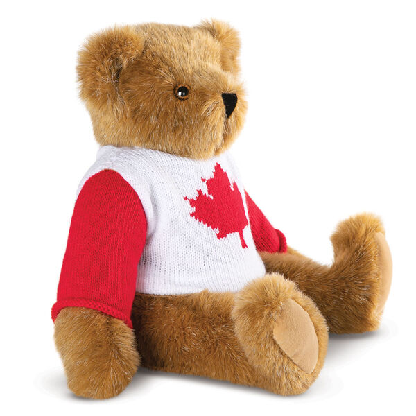 "15"" Maple Leaf Sweater Bear - Side view of seated jointed bear dressed in white knit sweater with red maple leaf on front and red sleeves - Honey brown fur image number 4"