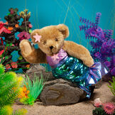 """15"""" Mermaid Bear - Front view of standing jointed bear dressed in a blue sequin tail and purple top with shell embroidery an pink starfish applique and earpiece in an underwater scene - honey brown fur image number 2"""