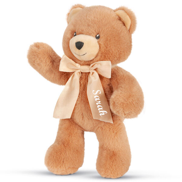 "13"" Cuddle Cub Bear with Bow - Three quarter view ofstanding golden bear waving its right arm, has tan muzzle and cream velvet bow image number 6"