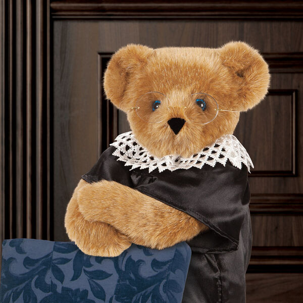 "15"" Ruth Bader Ginsburg Bear - Standing Honey Bear with blue eyes dressed in a black satin robe, white dissent color and gold wire framed glasses in iconic RBG pose image number 1"