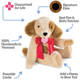 """15"""" Classic Puppy Dog - Seated jointed tan puppy dog, text around dog reads, """"Signature Eyes; Spot Eye and Belly Patches; Add a Name to Bow Tail; Poseable Limbs; 100"""" Handmadein Vermont; Guaranteed For Life"""".  image number 7"""