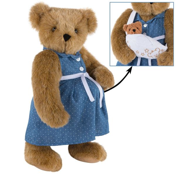 """15"""" Cub in the Oven - Three quarter view of standing pregnant jointed bear dressed in a blue dress with white dots and white belt. Inset of bear hoding a cub in a white sling.  - Honey brown fur image number 1"""