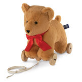 "12"" Rolling Bear Toy - Three quarter view of golden bear with red satin ribbon on wooden detachable wheel frame with pull cord image number 4"