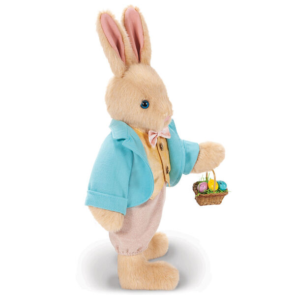 """16"""" Limited Edition Easter Bunny - Side view of Jointed Standing Buttercream Rabbit in a turquoise jacket, yellow vest with bow tie, tan knickers holding an Easter basket with eggs. image number 7"""