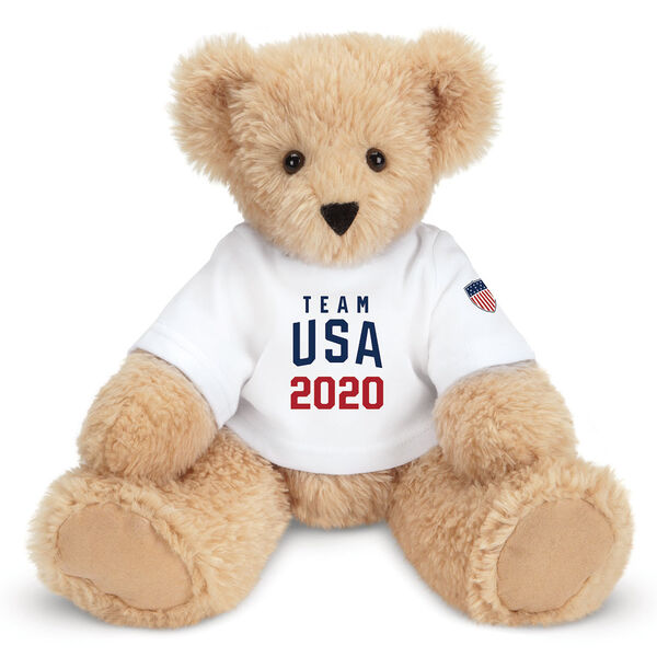 """13"""" Butterscotch Team USA 2020 T-Shirt Bear - Front view of Seated light brown bear in white T-Shirt with licensed Team USA 2020 logo and Olympic shield.  image number 0"""