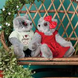 """15"""" Zombie Love Bear - Seated on a bench in a garden jointed bears with blackened eyes, embroidered scars and red heart tattoo on right arms wearing torn t-shirt and jeans and red velvet dress and hairbow - gray fur image number 3"""