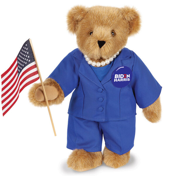 """15"""" Kamala Harris Bear - Standing Honey Bear with brown eyes, blue suit, faux pearl necklace, campaign pin holding an American flag. image number 0"""