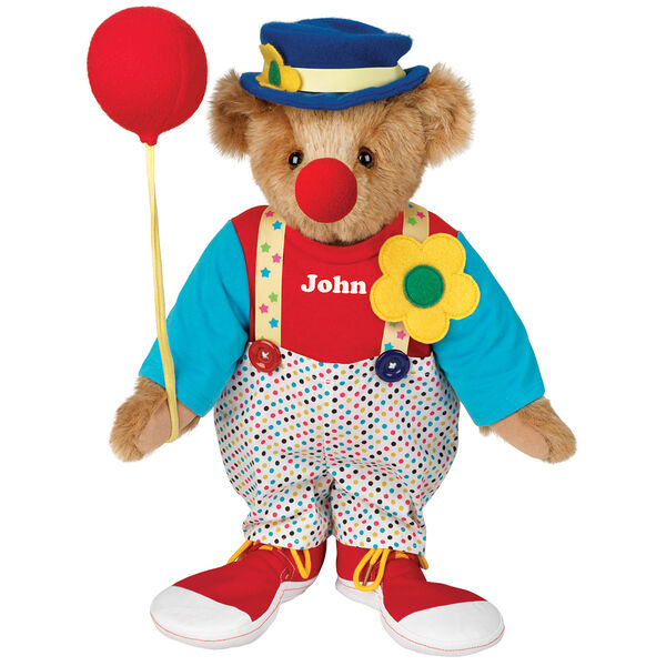 "15"" Clown Bear - Standing jointed bear dressed in dot pants with suspenders and daisy, red and blue shirt, blue hat, red clown shoes, and holds  red fabric balloon made personalized with ""John"" in white on shirt's center front - Honey brown fur image number 0"