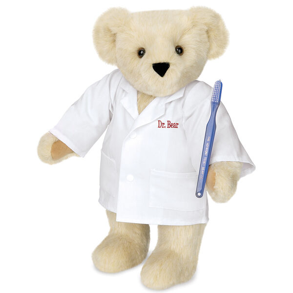 "15"" Dentist Bear - Three quarter view of standing jointed bear dressed in white labcoat and holding a toothbrush, personalized with ""Dr. Bear"" on left chest of coat in red lettering  image number 1"