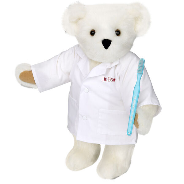 "15"" Dentist Bear - Three quarter view of standing jointed bear dressed in white labcoat and holding a toothbrush, personalized with ""Dr. Bear"" on left chest of coat in red lettering  image number 2"
