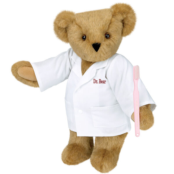 """15"""" Dentist Bear - Three quarter view of standing jointed bear dressed in white labcoat and holding a toothbrush, personalized with """"Dr. Bear"""" on left chest of coat in red lettering  image number 0"""