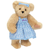 "15"" Mother Bear - Three quarter view of standing jointed bear dressed in blue floral dress and hair bow personalized with ""Susan"" in purple on bodice of dress - Maple brown fur image number 7"