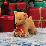 """12"""" Rolling Bear Toy - Three quarter view of golden bear with red satin ribbon on wooden detachable wheel frame with pull cord in Christmas setting image number 0"""