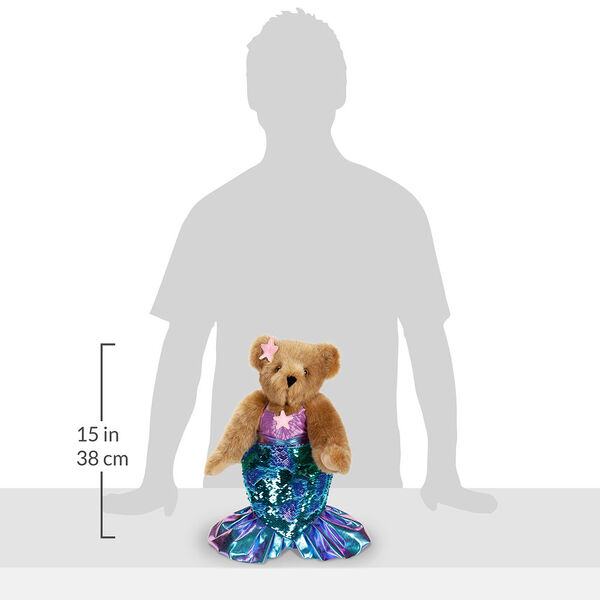 """15"""" Mermaid Bear - Front view of standing jointed bear dressed in a blue sequin tail and purple top with shell embroidery an pink starfish applique and earpiece with a measurement of 15"""" - Honey brown fur image number 10"""