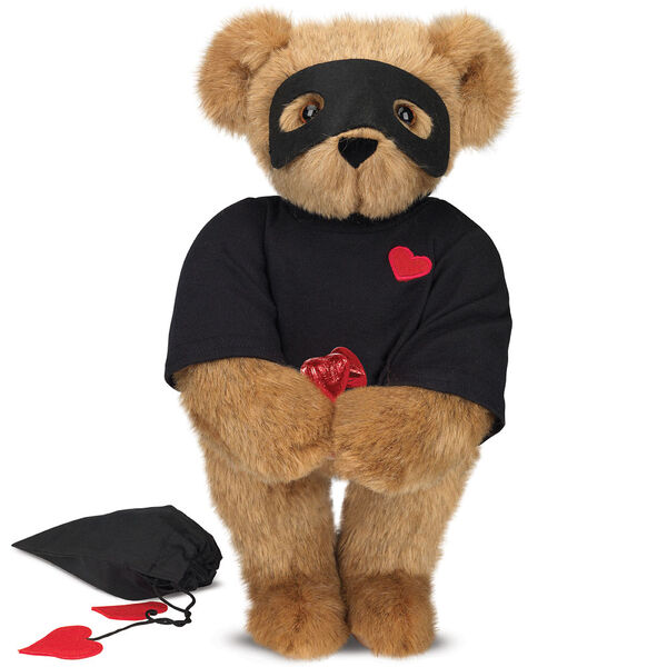 """15"""" Love Bandit Bear - Front view of standing jointed bear dressed in black turtleneck with red heart on left chest, black mask and holding a black bag with 2 chocolates - Honey brown fur image number 0"""