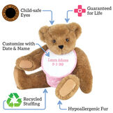 "15"" Baby Girl Bear - Seated jointed bear dressed in pink with white dots fabric diaper and bib, text around bear reads, ""Guaranteed For Life; Recycled Stuffing; Hypoallergenic Fur; Customize with Date and Name; Child-safe Eyes"".  image number 8"