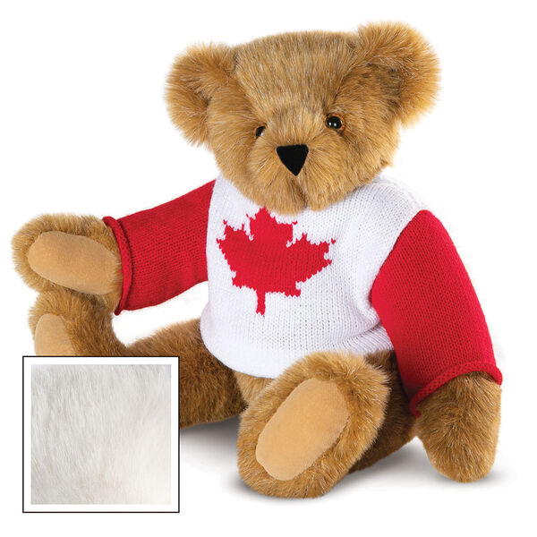 "15"" Maple Leaf Sweater Bear - Three quarter view of seated jointed bear dressed in white knit sweater with red maple leaf on front and red sleeves  - Vanilla white fur image number 2"