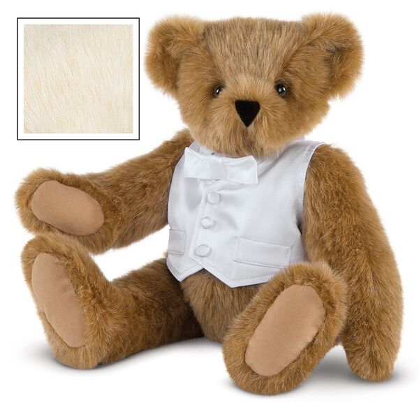 "15"" Special Occasion Boy Bear - Three quarter view of seated jointed bear dressed in a white satin vest and shirt front with bowtie - Buttercream brown fur image number 1"