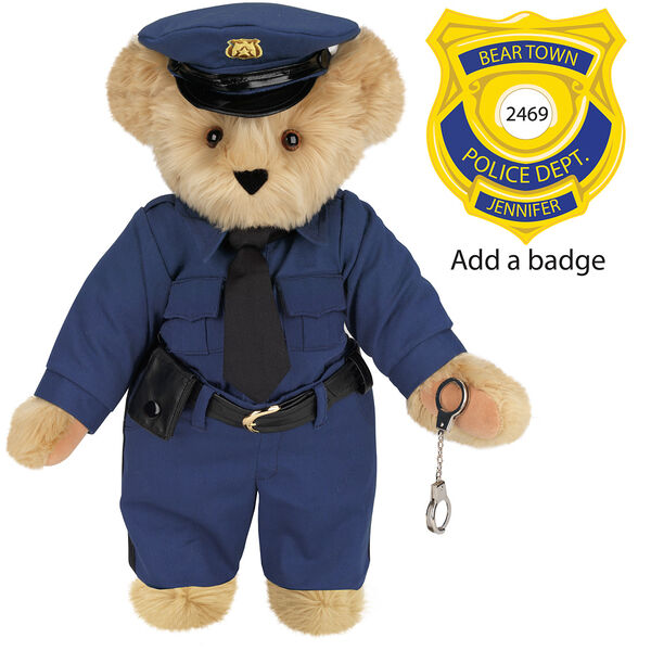 "15"" Police Officer Bear - Three quarter view of standing jointed bear dressed in a navy blue police uniform with shirt, pants, black tie and hat and holding handcuffs. Personalize with a Police badge - Maple brown fur image number 5"