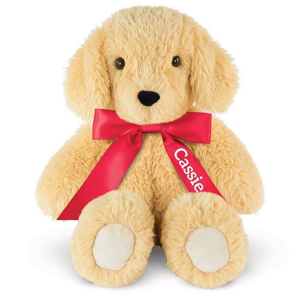 """18"""" Oh So Soft Puppy - Front view of seated tan 18"""" Puppy with tail and ivory foot pads wearing a red satin bow with tails personalized with """"Cassie"""" in white lettering image number 3"""