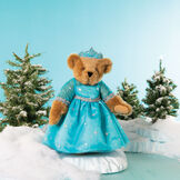 "15"" Winterland Queen Bear - Front view of jointed bear dressed in a blue dress with silver star tulle overlay and silver lace trim and blue and silver tiarain a winter landscape standing next to a lake image number 3"