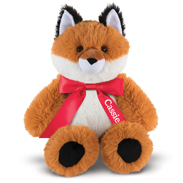"18"" Oh So Soft Fox - Front view of seated red Fox with white belly and muzzle and black tipped ears and foot pads wearing a red satin bow with tails personalized with ""Cassie"" in white lettering image number 2"