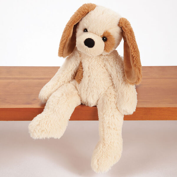 Buddy Puppy - Front view of tan Puppy with brown ears and spot sitting on a shelf image number 0