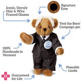 """15"""" Bernie Sanders Bear - Standing Honey Bear, Black suit with blue tie. Text reads, """"Signature Eyes; 'Feel the Bern' campaign pin; Poseable limbs; Guaranteed For Life; 100% Handmade in Vermont; Ironic, Unruly Hair and Wire Framed Glasses"""".  image number 1"""