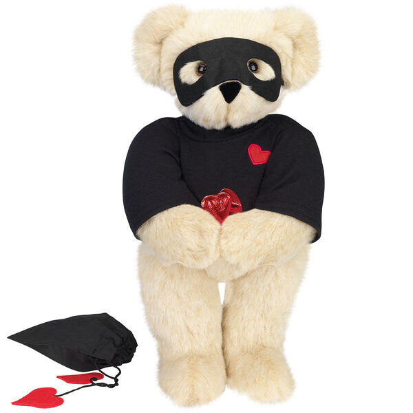 """15"""" Love Bandit Bear - Front view of standing jointed bear dressed in black turtleneck with red heart on left chest, black mask and holding a black bag with 2 chocolates - Buttercream brown fur image number 1"""
