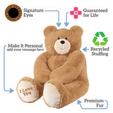 "4' Big Hunka Love Bear with I Love You Bow - Seated golden brown bear, text around the bear says, ""Signature eyes; Guaranteed for life; Recycled stuffing; Premium fur; Make it personal - add your message here"" image number 1"