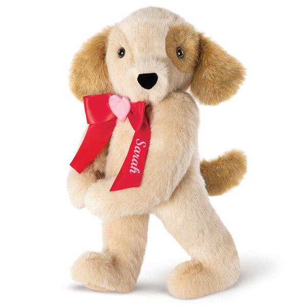 """15"""" Classic Puppy Dog - Three quarter view of Standing jointed tan puppy dog with honey brown spots, ears and taildressed in a red satin bow with pink heart in center personalized with """"Sarah"""" in white - Buttercream brown fur image number 3"""