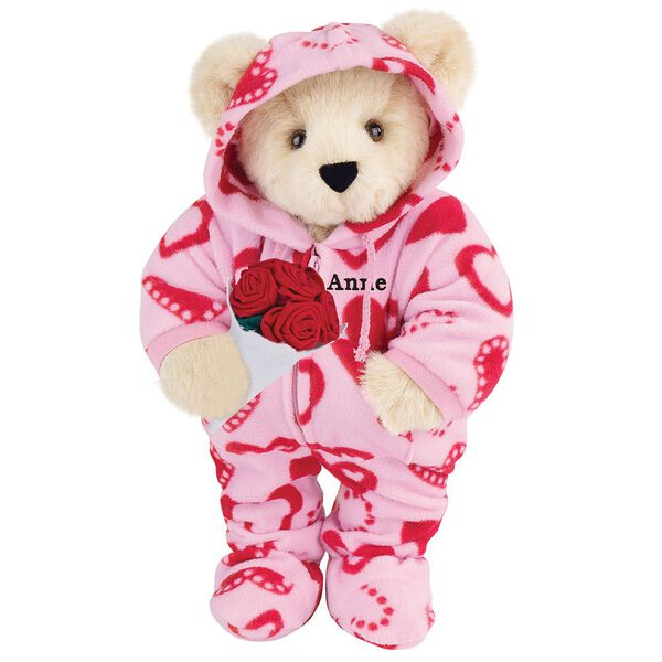 """15"""" Sweetheart Hoodie-Footie Bear with Red Roses - Front view of standing jointed bear dressed in pink hoodie footie with red heart pattern holding a bouquet of red roses, personalized with """"Anne"""" in black on left chest - Buttercream brown fur image number 1"""