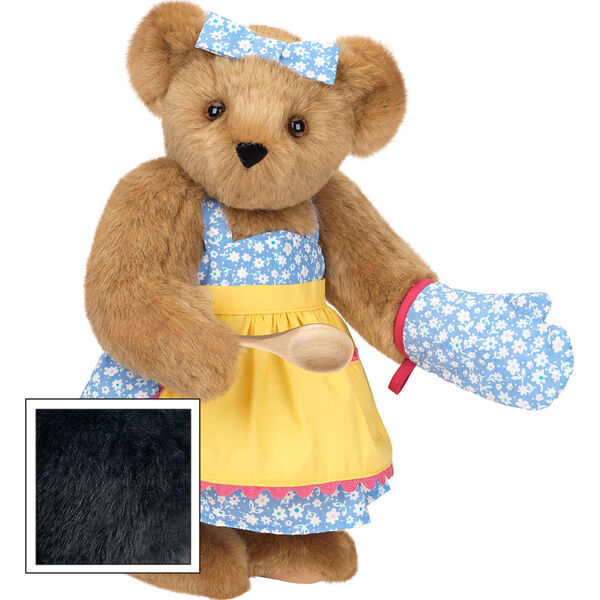 """15"""" Cooking Bear - Three quarter view of standing jointed bear dressed in a blue floral sundress and oven mitt, yellow apron with pink trim and holding a wooden spoon. Apron is personalized with """"Julietta"""" in hot pink - Black fur image number 3"""