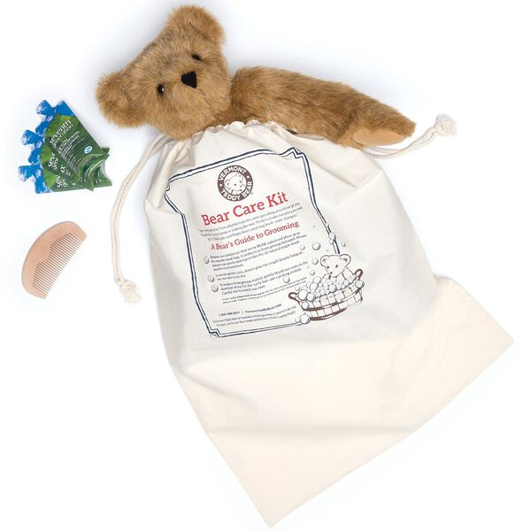 Bear Care Kit - top view of cloth bag with instructions for machine washing plush animals with comb and 3 soaps image number 0