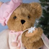 "15"" Bianca Bear - Close up view of Jointed Bear in Honey Fur dressed in ivory cape with snowflake design and pink hat holding a snowflake image number 3"
