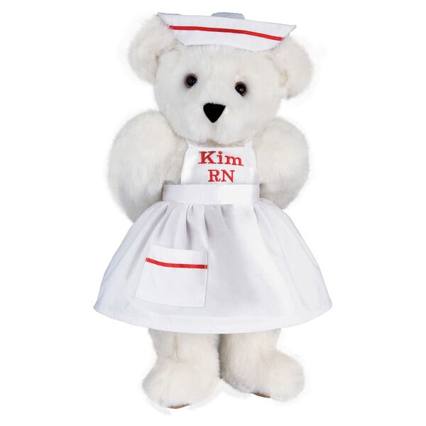 """15"""" Nurse Bear - Front view of standing jointed bear dressed in white nurse's dress and hat with red trim perosnlized with """"Kim RN"""" on bib of dress in red - Vanilla white fur image number 2"""