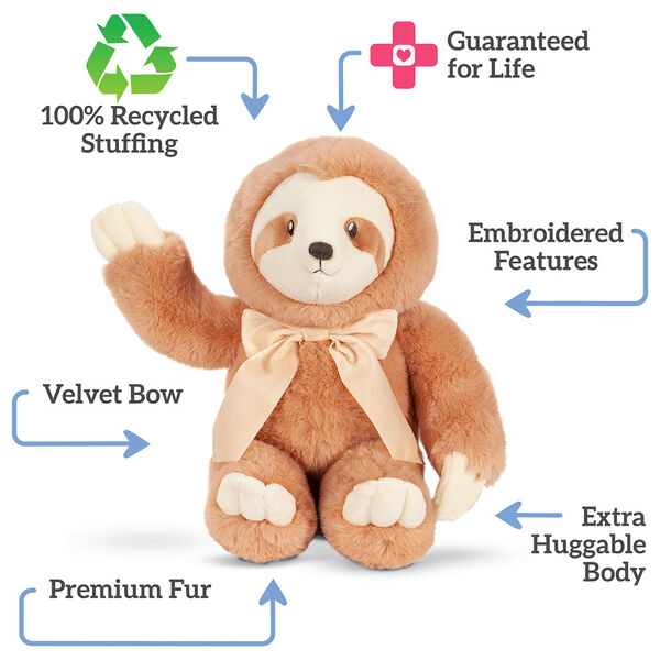 """13"""" Cuddle Cub Sloth with Bow - Front of seated golden brown sloth with tan muzzle and velvet bow, text says """"100% Recycled Stuffing; Guaranteed for Life; Embroidered Features; Extra Huggable Body; Premium Fur; Velvet Bow"""" image number 2"""