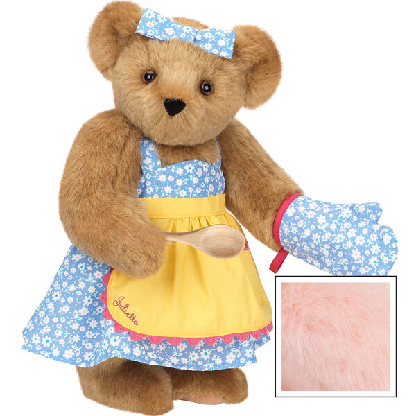 """15"""" Cooking Bear - Three quarter view of standing jointed bear dressed in a blue floral sundress and oven mitt, yellow apron with pink trim and holding a wooden spoon. Apron is personalized with """"Julietta"""" in hot pink - Pink image number 5"""