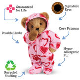 "15"" Hoodie-Footie Sweetheart Bear - Standing  jointed bear dressed in pink hoodie footie with red heart pattern, text around bear reads, ""Signature Eyes; Poseable Limbs; Recycled Stuffing; Hypo-Allergenic Fur; Cozy Pajama; Guaranteed For Life"".  image number 7"