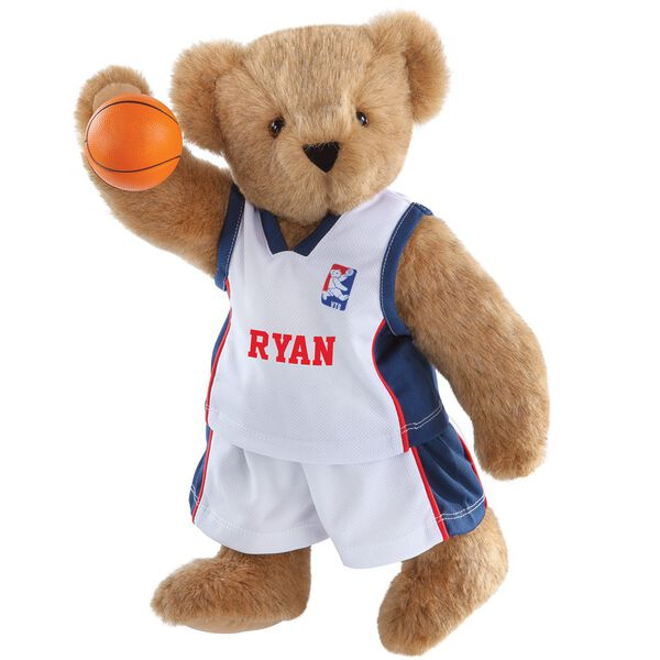 "15"" Basketball Bear - Standing jointed bear dressed in white jersey and shorts with blue and red trim. Bear comes with orange basketball. Center front of shirt is personalized with ""Ryan"" in red lettering - Honey brown fur image number 0"