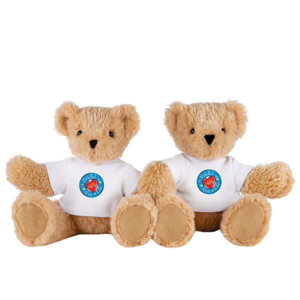 """13"""" Little Hero Bear - Buy 1, Give 1 - Front view of 2 butterscotch light brown bears in white t-shirts with Little Hero Friend for Life Logos image number 1"""